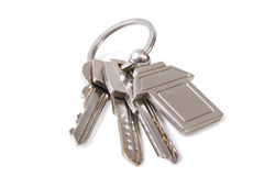 Three key and keychain Royalty Free Stock Photo