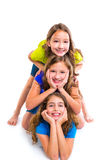 Three kid girls friends happy stacked in a row Royalty Free Stock Photos