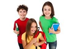 Kids holding books isolated on white background Stock Photos