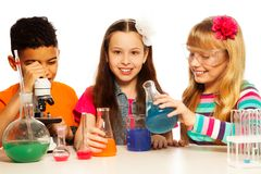 Three Kids And Chemistry Lesson Royalty Free Stock Photo