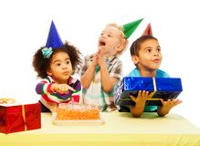 Three kids with birthday cake and peresents Royalty Free Stock Photography