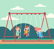 Three kids boys and girl swinging in public park Royalty Free Stock Photos