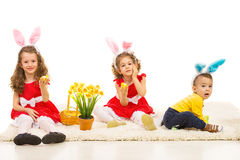 Three kids with bunny ears Stock Photo