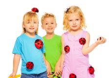 Three kids celebrating spring Stock Image