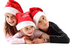 Three kids in christmas caps Royalty Free Stock Image