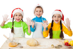 Three kids with Christmas cooking Royalty Free Stock Images