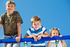 Three kids climbing up Royalty Free Stock Image