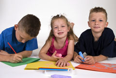 Three Kids Coloring Stock Photos