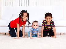 Three kids crawling Stock Images