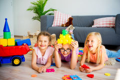 Three kids in daycare. A portrait of three girls in daycare stock image