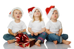 Three kids dreaming about christmas Stock Photo