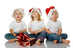 Three kids dreaming about christmas Stock Images
