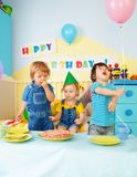 Three kids eating birthday cake Stock Photo