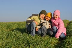 Three Kids in a Field Stock Photo