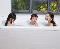 Three kids having a bath Royalty Free Stock Image