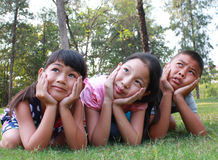 Three kids having good time in the park. Royalty Free Stock Photo