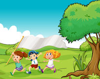 Three kids at the hilltop with an empty flag banner Royalty Free Stock Image