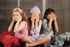 Three kids ignoring evil Stock Images