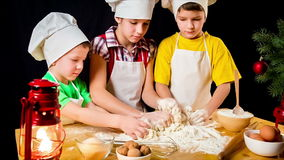 Three kids kneading the douhg stock video