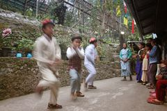 Kids dancing in a cultural program. Three kids of Lepacha tribe in North Sikkim are dancing in front of audience on the occasion of their New year celebration Stock Photo