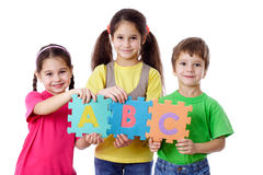Three kids with letters royalty free stock photos