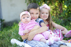 Three kids near colors Stock Images