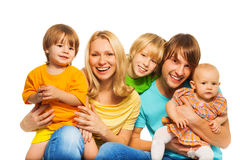 Three kids with parents. Happy laughing family with two parents and three little kids isolated on white Royalty Free Stock Photos