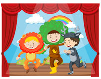 Three kids performing on the stage Royalty Free Stock Image