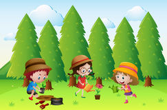 Three kids planting and watering the flowers Royalty Free Stock Image