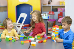 Three Kids Playing at Kindergarten Royalty Free Stock Photo