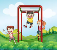 Three kids playing at the park Royalty Free Stock Photography