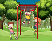 Three kids playing at the park Stock Images