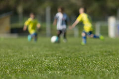 Three kids playing soccer Royalty Free Stock Photo