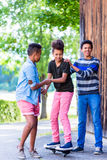 Three kids playing together with board Royalty Free Stock Images