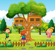 Three kids playing at the treehouse Royalty Free Stock Images