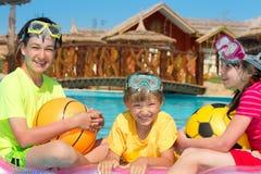 Three kids in the pool Stock Photo