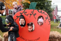Three kids posing in a pumpkin royalty free stock images