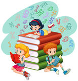 Three kids reading books Stock Images