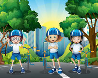 Three kids riding bicycle on the road Royalty Free Stock Photos