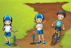Three kids riding bike with helmet on stock illustration