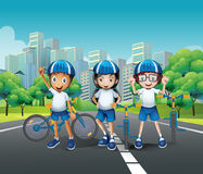 Three kids riding bike on the road Stock Photography
