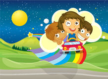 Three kids riding on a car passing over the rainbow Stock Photo