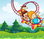 Three kids riding in the roller coaster stock illustration
