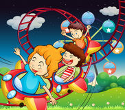 Three kids riding in a roller coaster. Illustration of the three kids riding in a roller coaster Stock Image