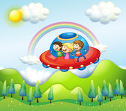 Three kids riding in the spaceship Royalty Free Stock Photography