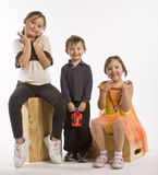 Three kids in a row Royalty Free Stock Images