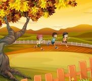 Three kids running along the field. Illustration of the three kids running along the field Stock Photos
