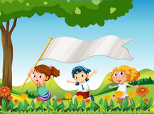 Three kids running with a banner Royalty Free Stock Photos