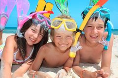 Three kids with snorkels. A portrait of three kids with snorkels and fins Royalty Free Stock Image