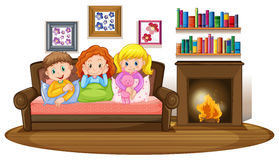 Three kids on sofa by the fireplace. Illustration Stock Photography